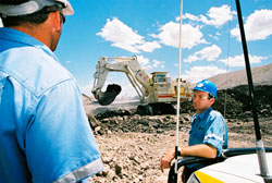 Employees observing trials of a new excavator at Dawson mine
